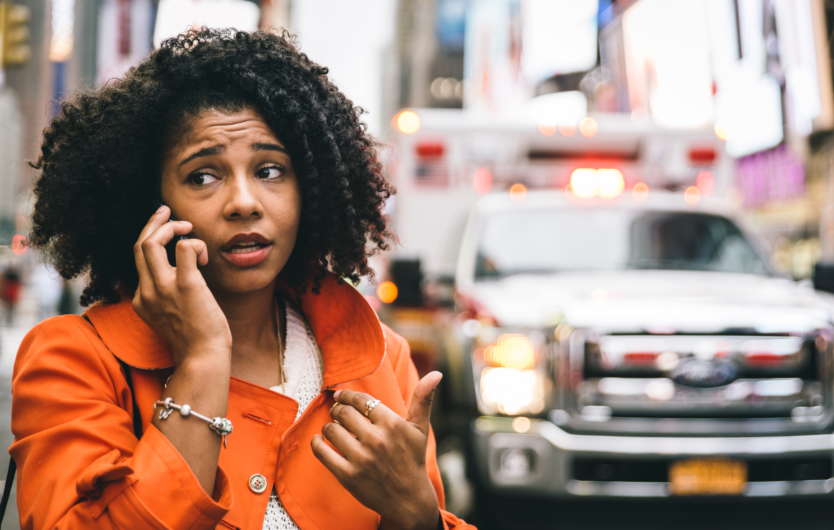 woman-worried-phone-call-car-accident-street