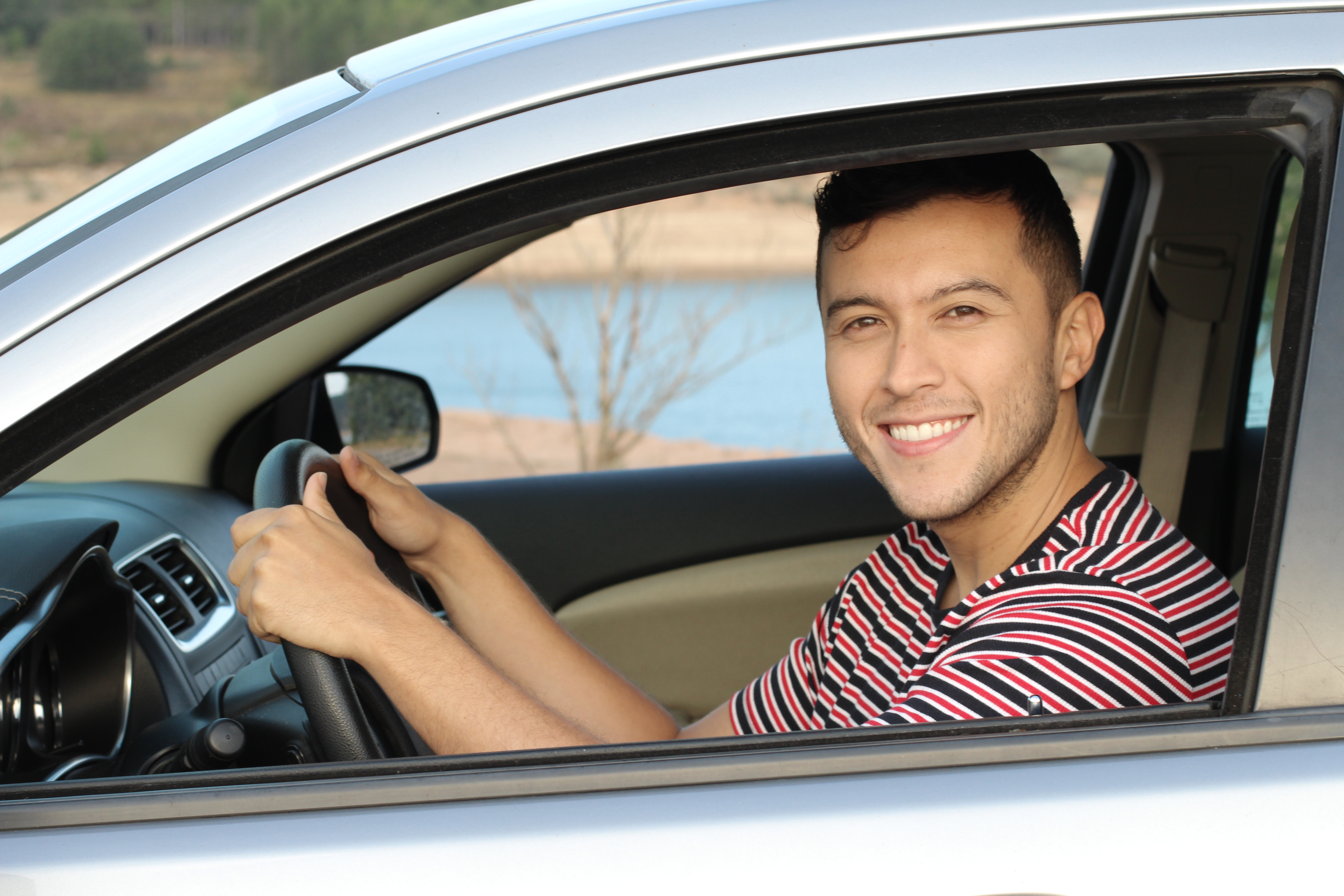 hispanic_man_driving_car_drivers_seat